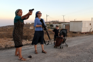 Female Jewish settlers practice firing weapons at the Jewish settlement of Pnei Kedem, near the West Bank town of Bethlehem. The women of Pnei Kedem decided to learn how to shoot guns for defensive purposes as a response to the Palestinans' bid for statehood recognition at the United Nations and the recent tensions which have been growing between Palestinians and Jewish settlers. September 21, 2011. Photo by Nati Shohat/FLASH90 *** Local Caption *** îúðçìéí ôðé ÷ãí îúðçìåú ðù÷ àéîåï äúðçìåéåú à÷ãç øåáä