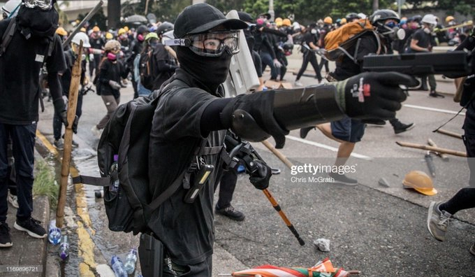 HK protester with a gun